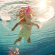 Swimming under the water girl with flower - Stock Photo