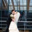 Stock Photo: Kiss of bride and groom