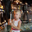 Child with candles — Stock Photo #22917220