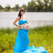 Stock Photo: Pregnant girl with butterflies