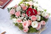 Wedding rings in flowers — Stock Photo