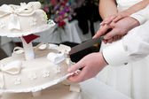Cut of a slice of a wedding cake — Stock Photo