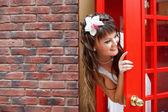 Bride in the telephone cabin — Stock Photo