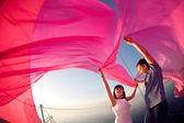 Couple under the sail — Stock Photo