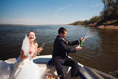 Bride and groom on the boat — Stock Photo
