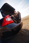 Man in trunk of car — Stock Photo