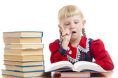 Girl thinking over the homework — Stock Photo