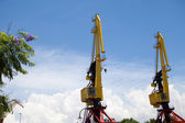 Two hoisting cranes — Stock Photo