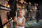 Child with candles — Stock Photo