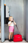 Child talking the phone in the airport — Stock Photo