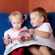 Two children looking painting — Stock Photo