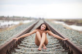Girl on the railway — Stock Photo