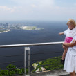 Girl and mom at a high viewing platform - Stock Photo