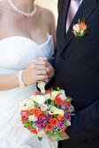 Bouquet and wedding ring — Stock Photo