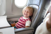 Crying child in airplane — Stock Photo