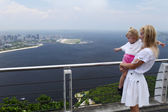 Girl and mom at a high viewing platform — Stock Photo