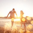 Couple running on the beach — Stock Photo #23160614
