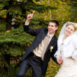Bride and groom  in autumn — Stock Photo