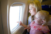 Mom and child in the plane — Stock Photo