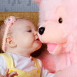 Small girl and toy bear — Stock Photo #23691131