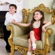 Boy and girl in the room — Stock Photo #23692475