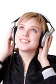 Happy girl in earphones — Stock Photo