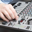 Royalty-Free Stock Photo: Adjusts setting of a synthesizer