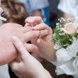 Putting on a wedding ring — Stock Photo #23703397