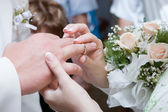 Putting on a wedding ring — Stock Photo