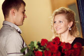 Man gives roses to a girl — Stock Photo