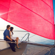 Couple under the red sail — Stock Photo