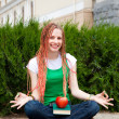 Girl meditating near school — Stock Photo #25396841