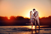 Couple on the beach in the evening — Stock Photo