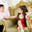 Stock Photo: Boy and girl in the room