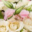 Royalty-Free Stock Photo: Gold rings and rose bouquet