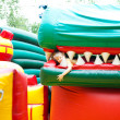 Girl in the inflatable entertainment park — Stock Photo