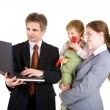Happy family looking into the screen of laptop — Stock Photo #26818541