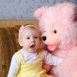 Stock Photo: Small girl and toy bear