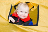 Child in a tent — Stock Photo