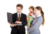 Happy family looking into the screen of laptop — Stock Photo