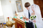 Bride and groom in the church — Foto Stock