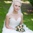 Stock Photo: Bride with flower bouquet