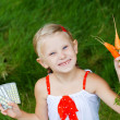 Girl with medicine and carrots — Stock Photo