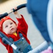 Child with a baby carriage — Stock Photo #29320095