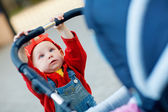 Child with a baby carriage — Stock Photo