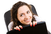 Businesswoman in armchair — Stock Photo