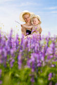 Mom and daughter with flowers — Stock Photo