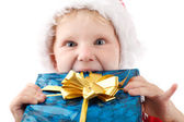 Small Santa with present — Stock Photo