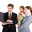 Stock Photo: Happy family looking into the screen of laptop