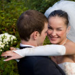 Bride hugging groom — Stock Photo